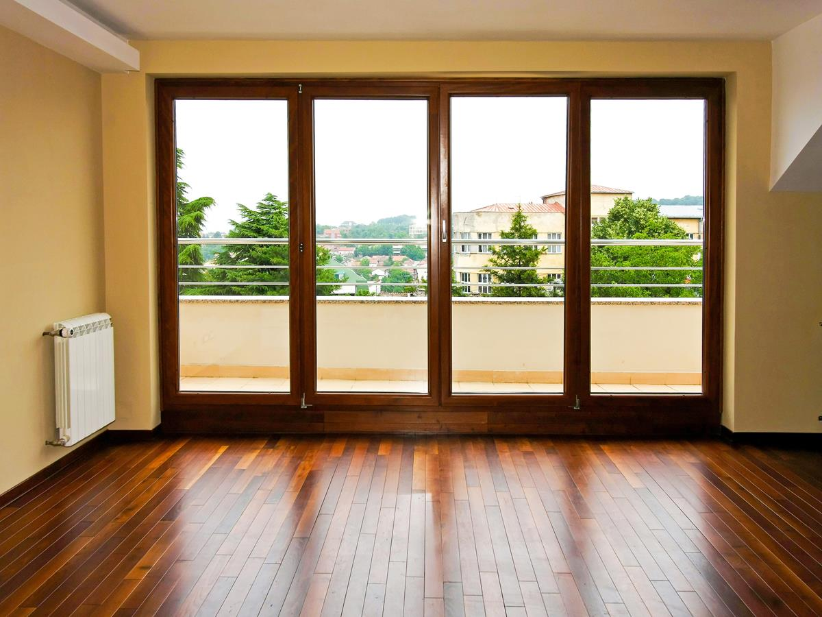 Four glass doors in empty living room