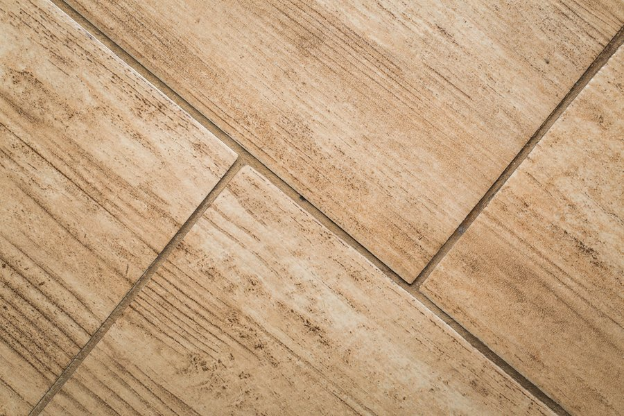 Close up of wood-like floor tile. Ceramic tile with wooden structure in close up - useful background.