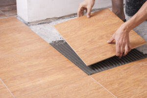master puts the ceramic tiles on the floor