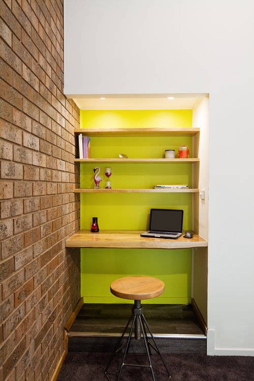 Lime green feature wall study nook in contemporary living room