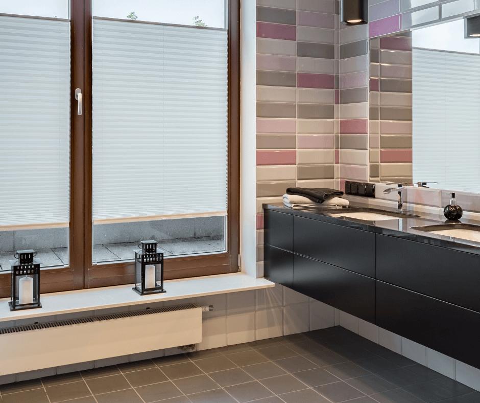 bathroom with window, big mirror and brick tiles